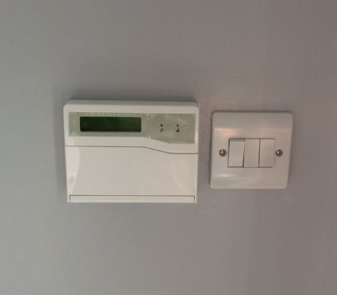 2nd Fixed Wiring Accessorys including a 3 gang light switch and a Security Alarm Keypad